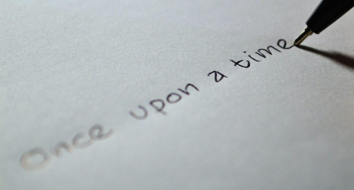 """Kuvituskuva. Musta kynä kirjoittaa paperille """"Once upon a time"""". Kuva: PIxabay."""